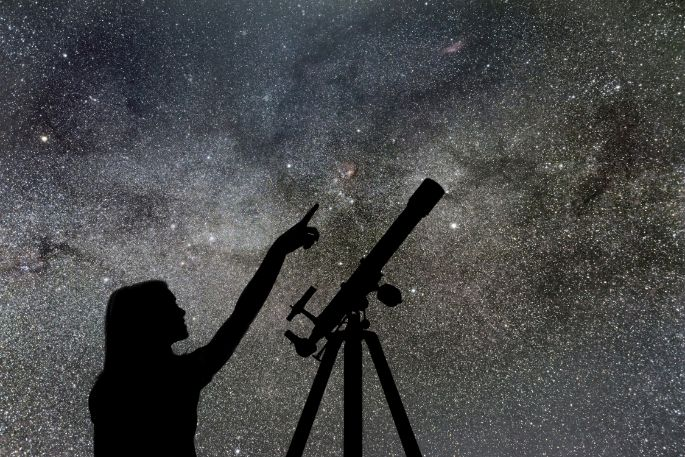 Woman Viewing Deep Space Objects With A Telescope