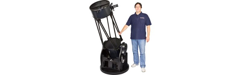 Man Standing Next To Orion Skyquest Xx16g Telescope