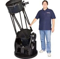Man Standing Next To Skyquest Xx16g Telescope